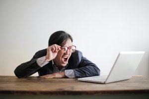 Man screaming at his laptop